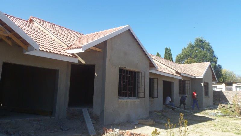 Supply and laying of roof tiles