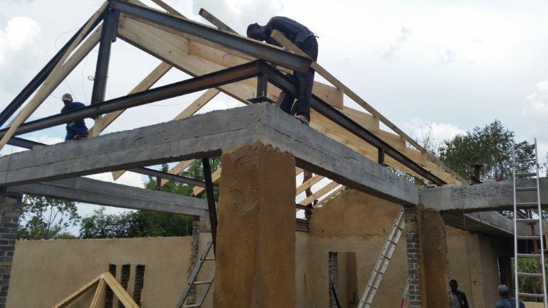 Exposed wooden trusses with IBeam and Laminated Wooden Beam