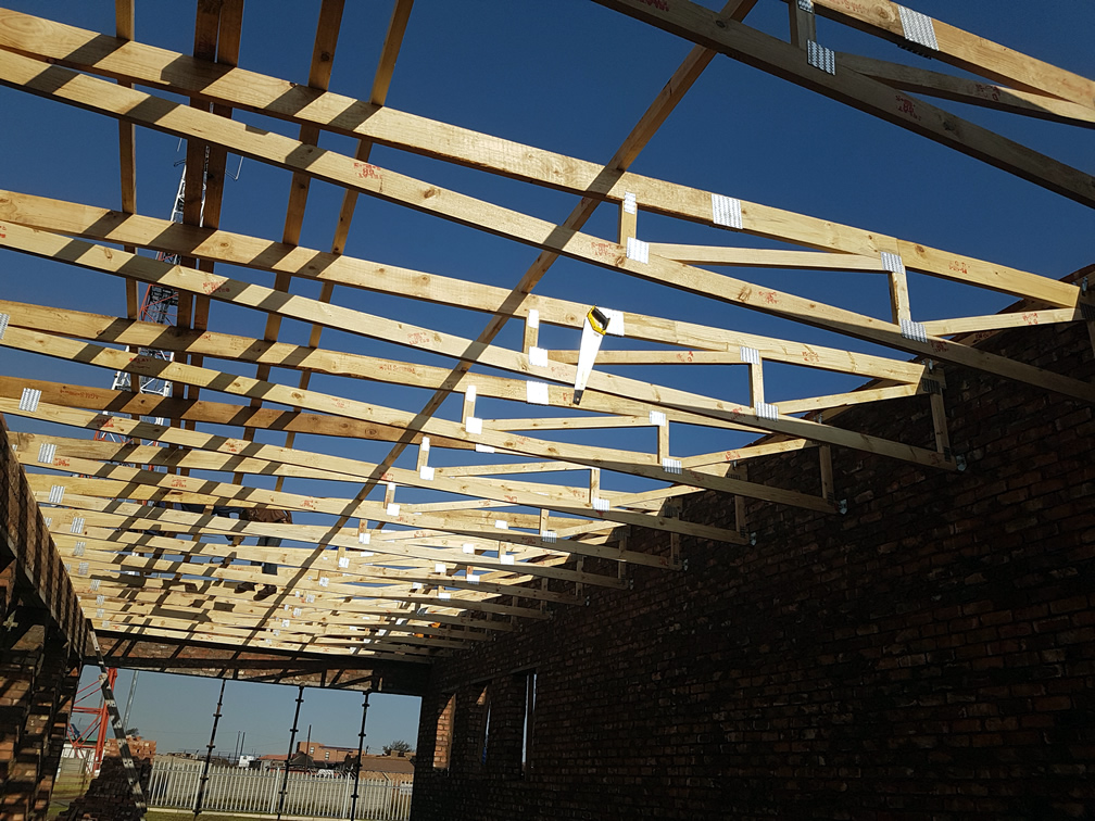 Fitment of prefabricated timber roof trusses